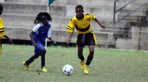 Eden Lodge's classy Sancho Springer (yellow shirt) had an excellent game against Deacons Primary.