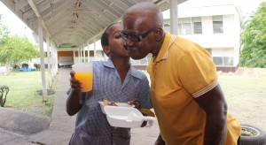 A BIG KISS: Class 4 student at Ellerton Primary School, Lloyd Smith, did not hide his gratitude at having been served a tasty and nutritious breakfast by Shirley Evelyn. This morning, the businesswoman treated the 40 students of the St. George school, some of whom are her customers, to breakfast as a way of saying thanks for patronising her service during the school year.