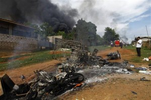 Burnt vehicles on a road in Myanmar following clashes between Muslims and Buddhists.