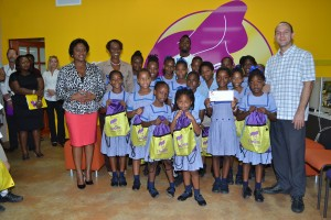 Advertising Manager of Chefette Restaurants (far left) and Marketing Officer of Chefette Restaurants, Marquest Clarke, in background and Managing Director of Chefette Restaurants, Ryan Haloute, (far right), join with the infants of West Terrace Primary School in celebrating their award of the Spirit of Event.