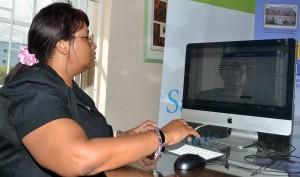 Dr. Joy St. John signing e-petition.