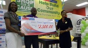Deborah Gittens of Cancer Support Services (right) accepting on behalf of the organisation.