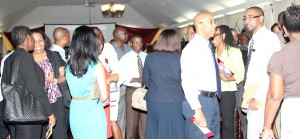 Medical professionals and CIBC First Caribbean International Bank officials interact at the end of the launch of the bank's Medical Professional Edge scheme.