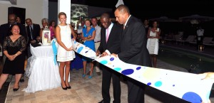 Tourism Minister, Richard Sealy (right) and owner of Soco Hotel, Ralph Taylor cut the ribbon to open the facility.