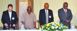 Praying for Bim: John Williams, Sir Roy Trotman, Cedric Murrell and PM Freundel Stuart.