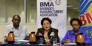BMA Executive Director (centre) with Beverages Caribbean Limited's Henry Yearwood (left) and BMEX Coordinator Ann Johnson.