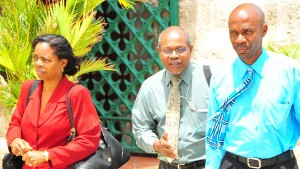 Auditor General Leigh Trotman (right) and other officials at Parliament today.