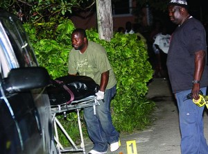 The body of William Scott being taken from the crime scene.
