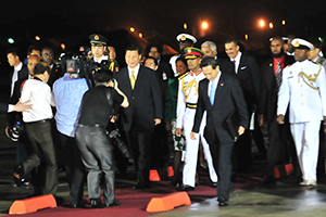 Trinidadian and Chinese officials walk during the arrival of Chinese President Xi Jinping to Trinidad recently.