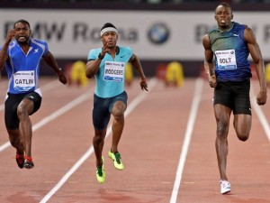 Justin Gatlin (left) defeating Usain Bolt (right) this evening. Michael Rodgers of the United States is at centre.