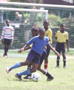 St. Bartholomew's Thierry Gale (blue shirt) could present Deacons Primary with plenty headaches tomorrow.