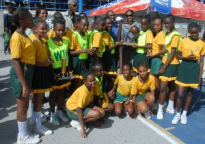 The victorious Boscobelle Primary School Netball Team posing with their trophies.