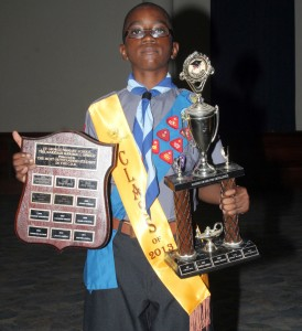 Valedictorian Ginuwine Padmore with his prizes of most outstanding student and the Nassco Award For Excellence.