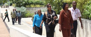 Cane Garden, St.Thomas residents with MP Cynthia Forde (third from right) entering the Supreme Court precints today.