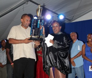 Winner Big Brown receiving her trophy from Minister of Tourism Richard Sealy.