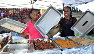 [At Left] Donna Clarke and Charika Pilgrim of Rika's displaying the food that they had on sale.