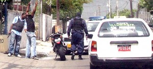Jamaica cops on stop and search mission.