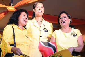 Kamla Persad-Bissessar (left) with other UNC party members.