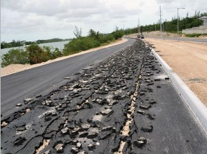 A newly paved stretched of JFK Drive was damaged early Saturday morning after a Caterpillar D8 tractor was used to intentionally dig up a portion of the road.