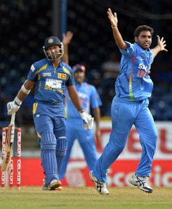 Bhuvneshwar Kumar (right) ran through Sri Lanka's top order to lead India to victory.
