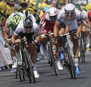 Marcel Kittel of Germany (right) sprints towards the finish line ahead of Mark Cavendish of Britain (left) to win the 12th stage of the Tour de France.