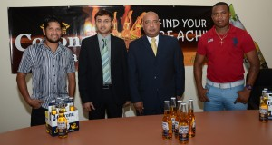 (From left) Ramnaresh Sarwan, Ravie Ramcharitar, Wayne James and Christopher Barnwell at the Corona signing.