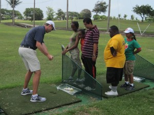 Special athletes getting some golf tips.