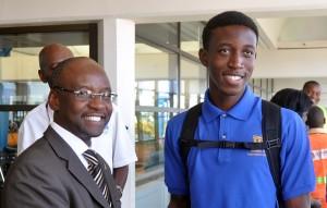 Minister of Sports Stephen Lashley (left) greeting Mario Burke.