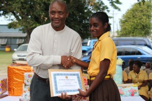 Zaria Taylor accepts her certificate for participation in the a  Barbados Entrepreneurship Foundation's $20 Challenge from Samuel Rouse.