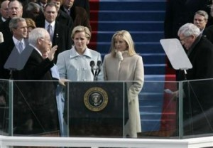 File photo of Liz Cheney watching her father Dick Cheney sworn in as US vice president