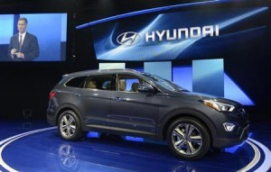 The 2013 Hyundai Santa Fe is seen at a news conference at the 2012 Los Angeles Auto Show in Los Angeles