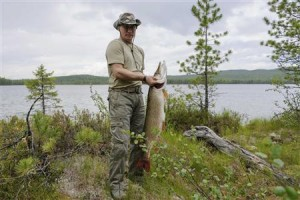 Russia's President Vladimir Putin poses for a picture as he fishes in Tyva Republic in the Siberian Federal District