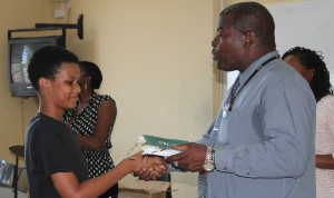 Jaquan Greaves receives his special award from Acting Senior Education Officer, Fernando Carter.