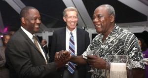 Minister of Industry, Donville Inniss (left) greeting ICBl's Vice Chairman Carlos Holder (right) while Chairman John Wight (centre) looks on.