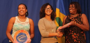 St. Croix team Kaylisha Jarris (left) and Elle Abraham (centre) receive the prize for Best Media Presence from Loretta Skeete of the Caribbean Media Corporation.