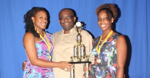 Caribbean Junior Duelling champs Neka André and Tessa Wilson pose with Chef Peter Edey.
