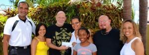 John Roett (third left) handing over the cheque to the family of Keana Banfield.