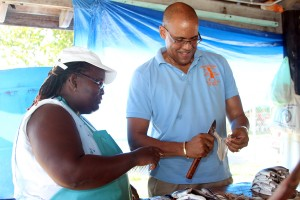 Symmonds seemed to be receiving some tips on boning fish from former Oistins Fish Festival champion Sheena Squires, when the Barbados Labour Party took their walk about to the fishing village this evening.
