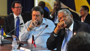 Prime Ministers Ralph Gonsalves and Baldwin Spencer listen to colleague Fruendel Stuart.