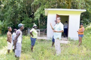 Councillor for the Cambridge Division Homer Davis (third right) addresses residents of Richmond Hill last weekend, following the theft of the water pump in the deep rural community.