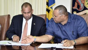 Tourism minister Richard Sealy and Minister of Finance Chris Sinckler.