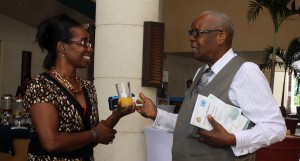 Former Prime Minister Sir Lloyd Sandiford with NUPW's Margo Bannister.