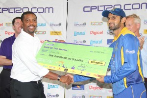 Man of the Match Shoaib Malik (right) receiving his award from WICB president Dave Cameron.