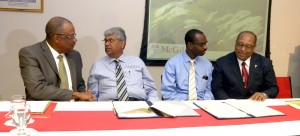 Health Minister John Boyce (left) and Agriculture Minister, Dr David Estwick (right) during the signing of a Food Security MOU between the UWI, Cave Hill and McGill University of Canada at Cave Hill today.