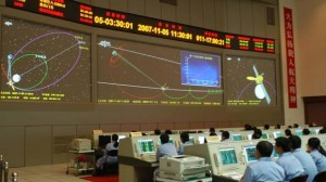 In this photo released by China's Xinhua News Agency, scientists work at the Beijing Aerospace Control Center (BACC) in Beijing Monday, Nov. 5, 2007. China's first lunar probe, Chang'e 1, successfully entered lunar orbit Monday after completing a planned braking operation.