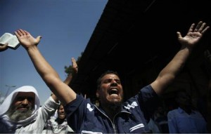 Supporters of Muslim Brotherhood and ousted Egyptian President Mohamed Mursi shout slogans in Cairo