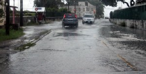 These vehicles make their way through the flood water on Jemmotts Lane.
