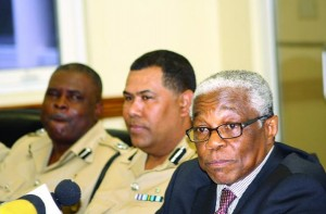 From right: Minister of National Security Dr. Bernard Nottage, Commissioner of Police Ellison Greenslade and Assistant Commissioner of Police Anthony Ferguson.