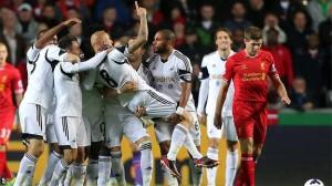 Swansea's mid- fielder Jonjo Shelvey and team- mates celebrate their goal.