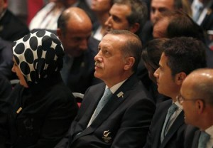 Turkish Prime Minister Tayyip Erdogan sits with members of the Istanbul bid committee.